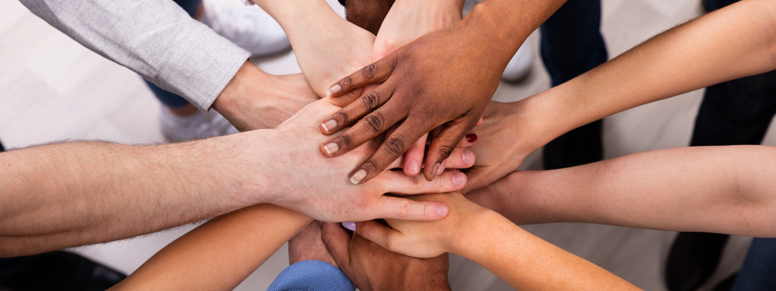 Hands of a diverse group of people