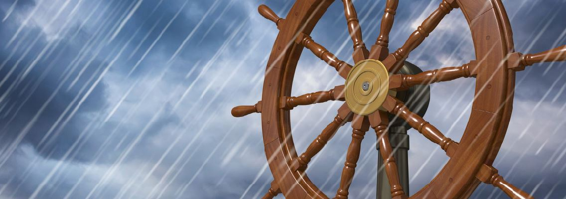 graphic of ships' wheel in a rain storm