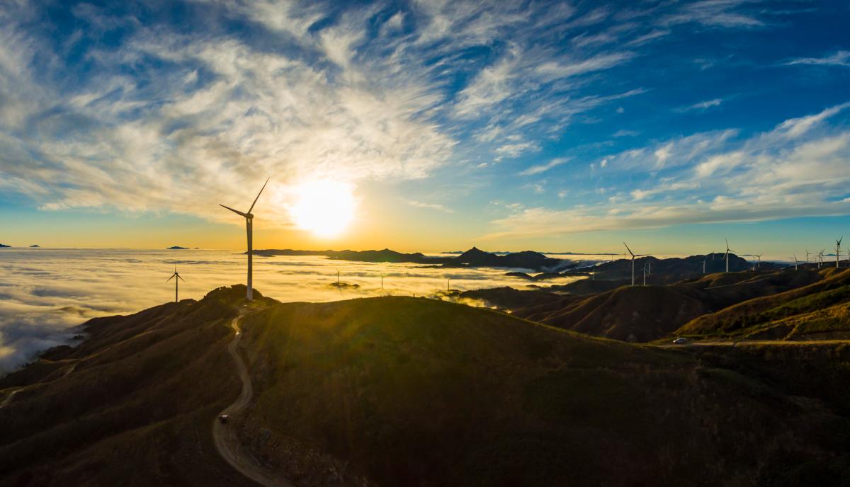 sunset on a wind turbine farm